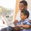Mixed Race Father and Son Reading Park Brochure Outside — Stock Photo