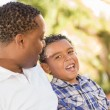 Happy Mixed Race Father and Son Talking - Stok fotoğraf