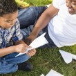 Mixed Race Father and Son Playing with Paper Airplanes — Stock Photo #11634555