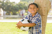 Mixed Race Boy Holding Soccer Ball in the Park — Stock Photo