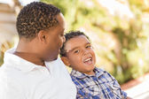 Happy Mixed Race Father and Son Talking — Stockfoto