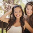 Attractive Mixed Race Girlfriends Smile Outdoors — Stock Photo #11903562