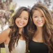 Attractive Mixed Race Girlfriends Smile Outdoors — Stock fotografie