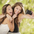 Attractive Mixed Race Girlfriends Taking Self Portrait with Came — Stock fotografie