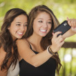 Attractive Mixed Race Girlfriends Taking Self Portrait with Came — Stockfoto