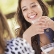 Attractive Girlfriends Laughing Sitting Outside — Stock Photo #11903641