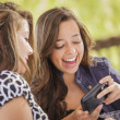 Stockfoto: Mixed Race Girls Working on Electronic Devices