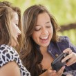 Stock Photo: Mixed Race Girls Working on Electronic Devices