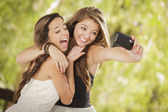 Attractive Mixed Race Girlfriends Taking Self Portrait with Came — Stock Photo