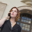 Young Businesswoman On Cell Phone in Front of City Hall - Stock Photo