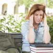 Female Student Outside with Headache Sitting with Books and Back — Stock Photo