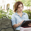 Young Female Student Outside on Bench Using Touch Tablet — Stock Photo