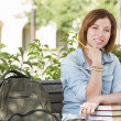 Young Female Student On Campus with Backpack on Bench — Stock Photo #12138800