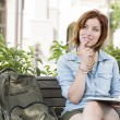 Young Female Student On Campus with Backpack on Bench — Stock Photo