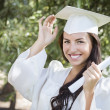 Royalty-Free Stock Photo: Graduating Mixed Race Girl In Cap and Gown with Diploma