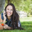 Mixed Race Young Female Talking on Cell Phone Outside — Stock Photo #12193524
