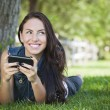 Mixed Race Young Female Texting on Cell Phone Outside — Stock Photo #12193618