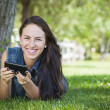 Mixed Race Young Female Texting on Cell Phone Outside — Stock Photo #12193625