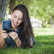 Mixed Race Young Female Texting on Cell Phone Outside — Stock Photo #12193639