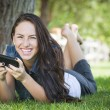 Mixed Race Young Female Texting on Cell Phone Outside — Stock Photo #12193651