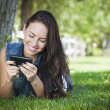 Mixed Race Young Female Texting on Cell Phone Outside — Foto Stock