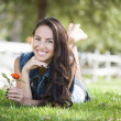 Attractive Mixed Race Girl Portrait Laying in Grass — Stock Photo