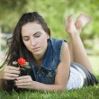 Stock Photo: Attractive Mixed Race Girl Portrait Laying in Grass