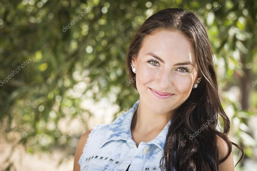 Attractive Smiling Mixed Race Girl Portrait Outdoors. — Stock Photo #12193734
