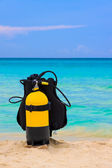 Scuba diving equipment on a beach — Stock Photo