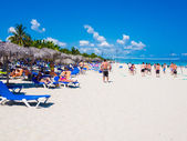 Young tourists at Varadero beach in Cuba — Stock Photo