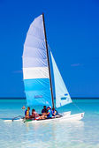 Tourists sailing in a catamaran in Cuba — Stock Photo