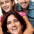 Portrait of a happy hispanic family — Stock Photo #11373735