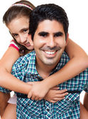 Hispanic gather carrying her daughter — Foto Stock