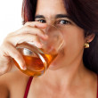 Beautiful hispanic woman drinking whisky — Stock Photo