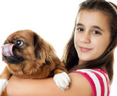 Hispanic girl carrying a small dog — Stock Photo
