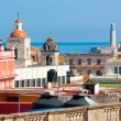 Stock Photo: Roofs of Old Havanwith El Morro in background