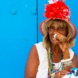 Colorful old black lady with a fine cuban cigar — Stock Photo #11798943