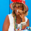 Colorful old black lady with a fine cuban cigar — Stock Photo #11798944