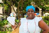 Black woman selling roasted peanuts in Havana — Stock Photo