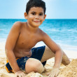 Latin boy on a tropical beach — Stock Photo