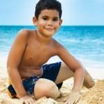 Latin boy on a tropical beach — Stock Photo