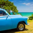 Stock Photo: Old americcar at beach in Cuba
