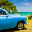 Old americcar at beach in Cuba — Stock Photo #11836843