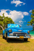 Old american car at a beach in Cuba — Stock Photo