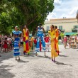 Street dancers on stilts at a carnival in Old Havana - Stock Photo
