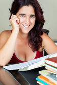 Adult hispanic woman studying — Foto Stock