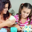 Mother and daughter making origami — Foto de Stock