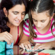 Mother and daughter making origami — Stockfoto