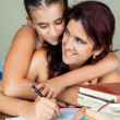 Stock Photo: Latin mother and daughter studying