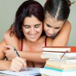 Latin mother and daughter studying — Foto Stock